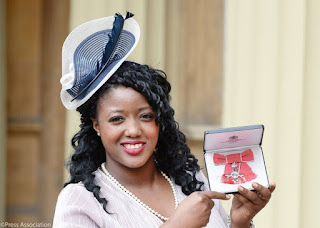 Anne marie imafidon decorated with MBE at Buckingham palace