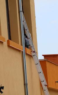 Bekir fixing upstairs fly screens