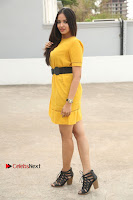 Actress Poojitha Stills in Yellow Short Dress at Darshakudu Movie Teaser Launch .COM 0318.JPG