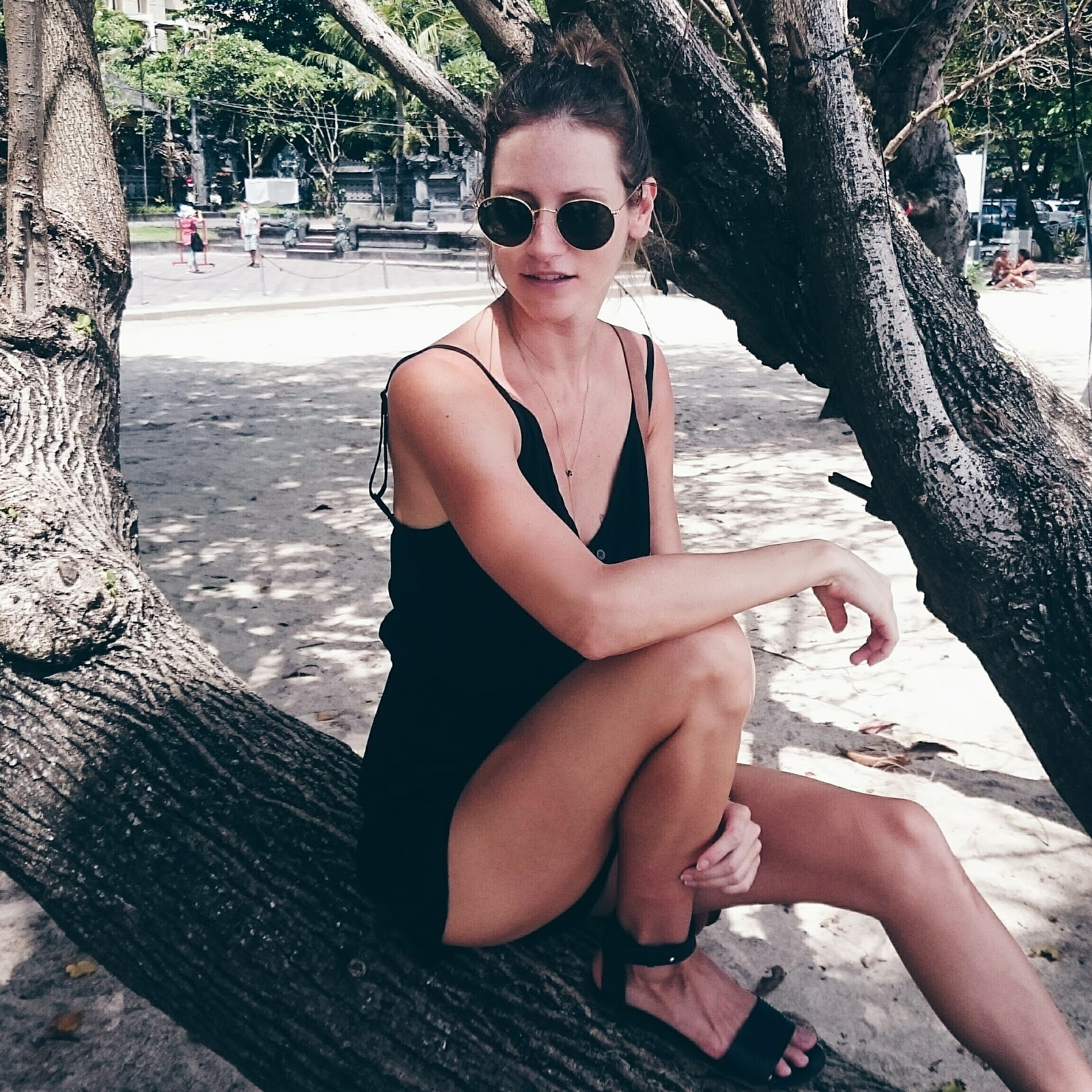 Fashion and travel blogger, Alison Hutchinson, at Kuta beach, Bali, in a Kayvalya Romper