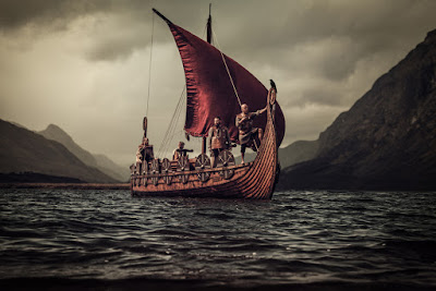 Vikings sailing on a ship towards Iceland