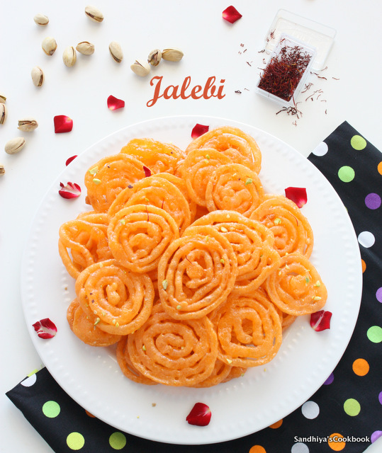 Sandhiyas cookbook home made crispy juicy jalebi jalebi recipe i really loved to see how effortlessly they make those jalebi and the cost was just 15 rs 100 gram of jalebi since i love to eat them as hot forumfinder Image collections