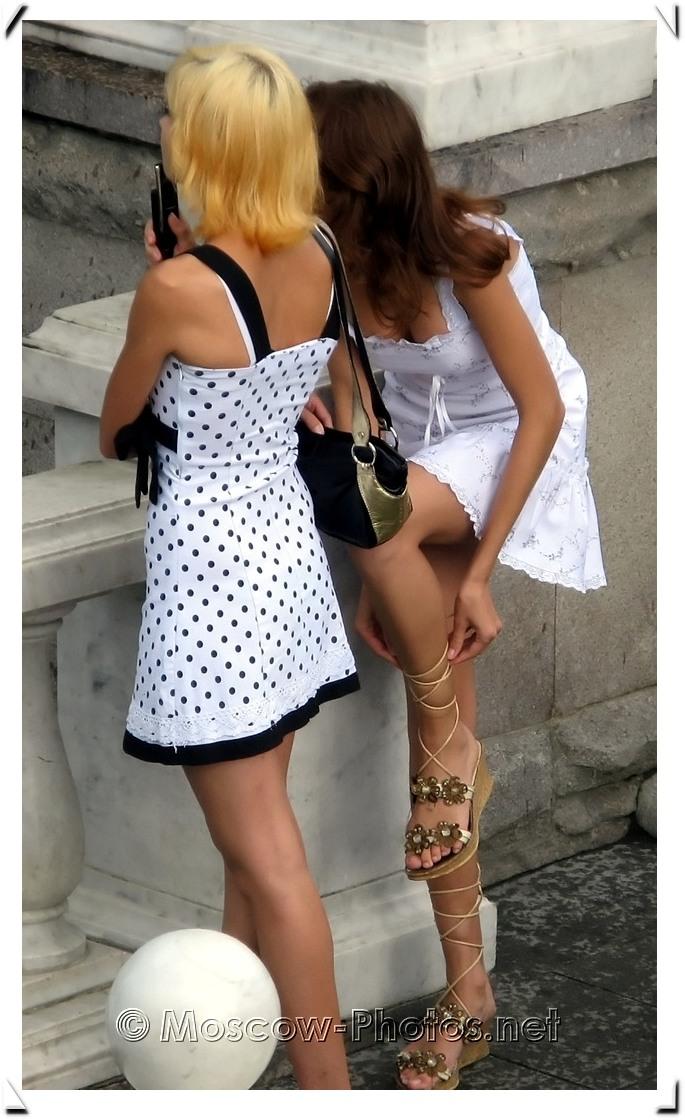 Beautiful russian girls in white summer elegant dresses