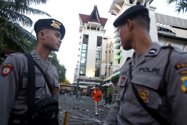 Family of suicide bombers attack Indonesia churches; 13 dead