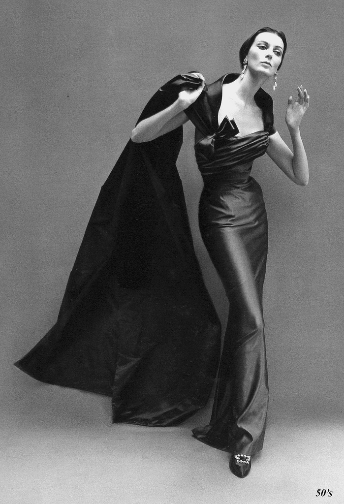 Carmen Dell'Orefice in a sensous long satin sheath dress by Balmain. Photo by Richard Avedon for Harper's Bazaar, October 1957.