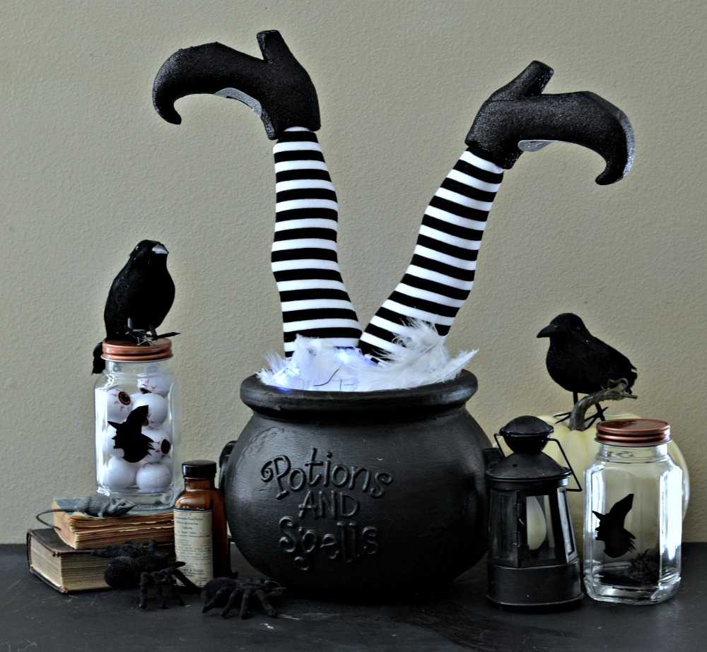 holiday decoration using black and white striped legs to create a fun Halloween decoration with lights
