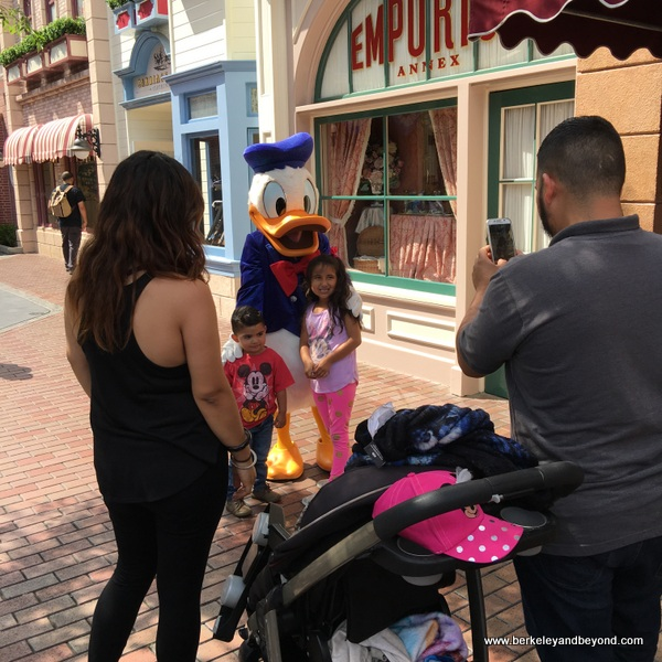 Donald Duck poses with kids at Disneyland