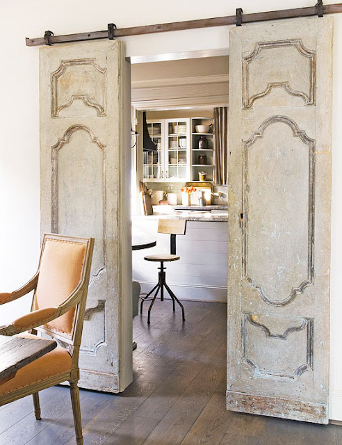 Sliding elegant antique doors in French Country room design by Eleanor Cummings