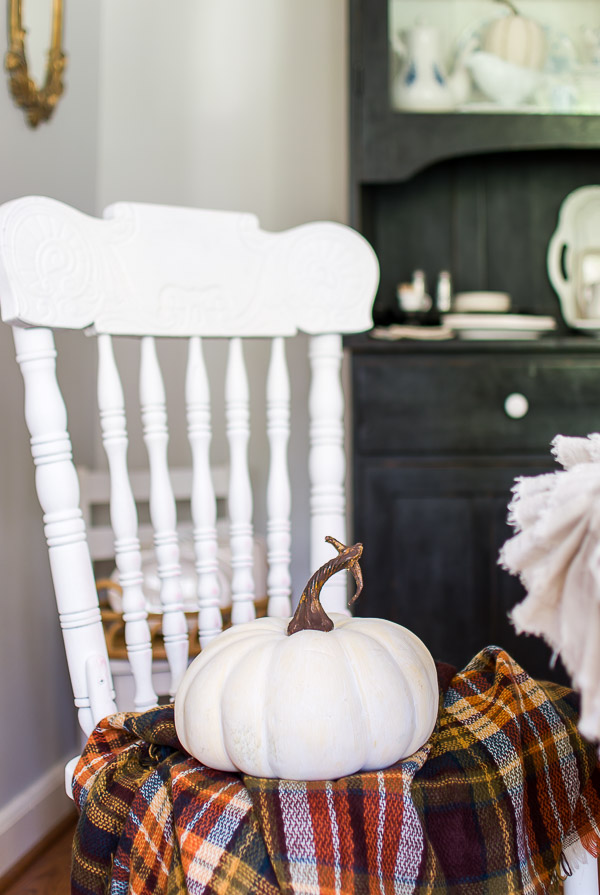 fall throw and white pumpkin