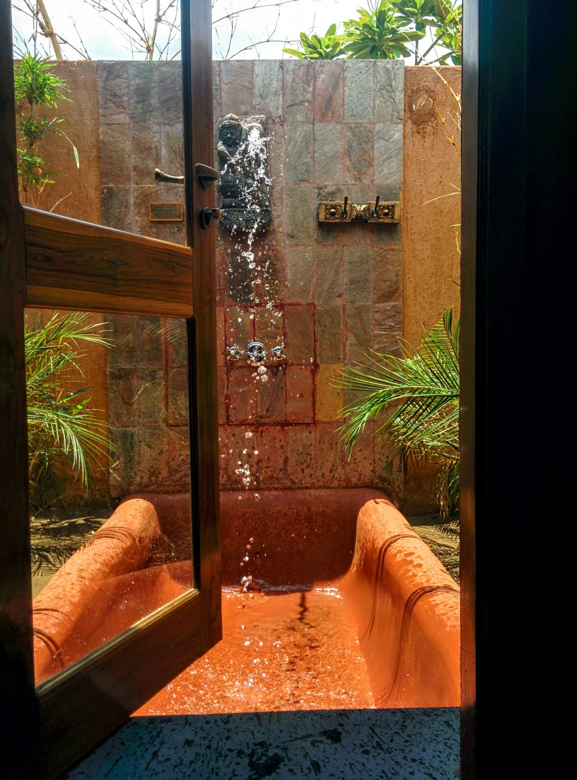 Traditional Clay Bath Tub and Gargoyle Shower - Bamboo Forest Safari Lodge