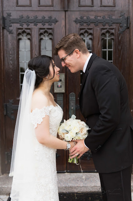 bride and groom in front of doors at Grosse Point Academy