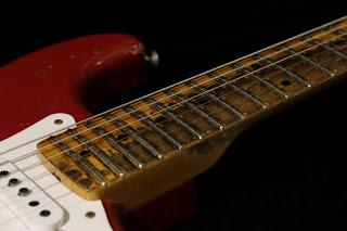 worn guitar fretboard