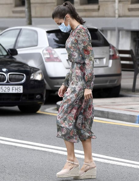 Queen Letizia wore a floral print midi dress from Zara, and canvas espadrille wedges by Macarena, Queen wore a gold earrings