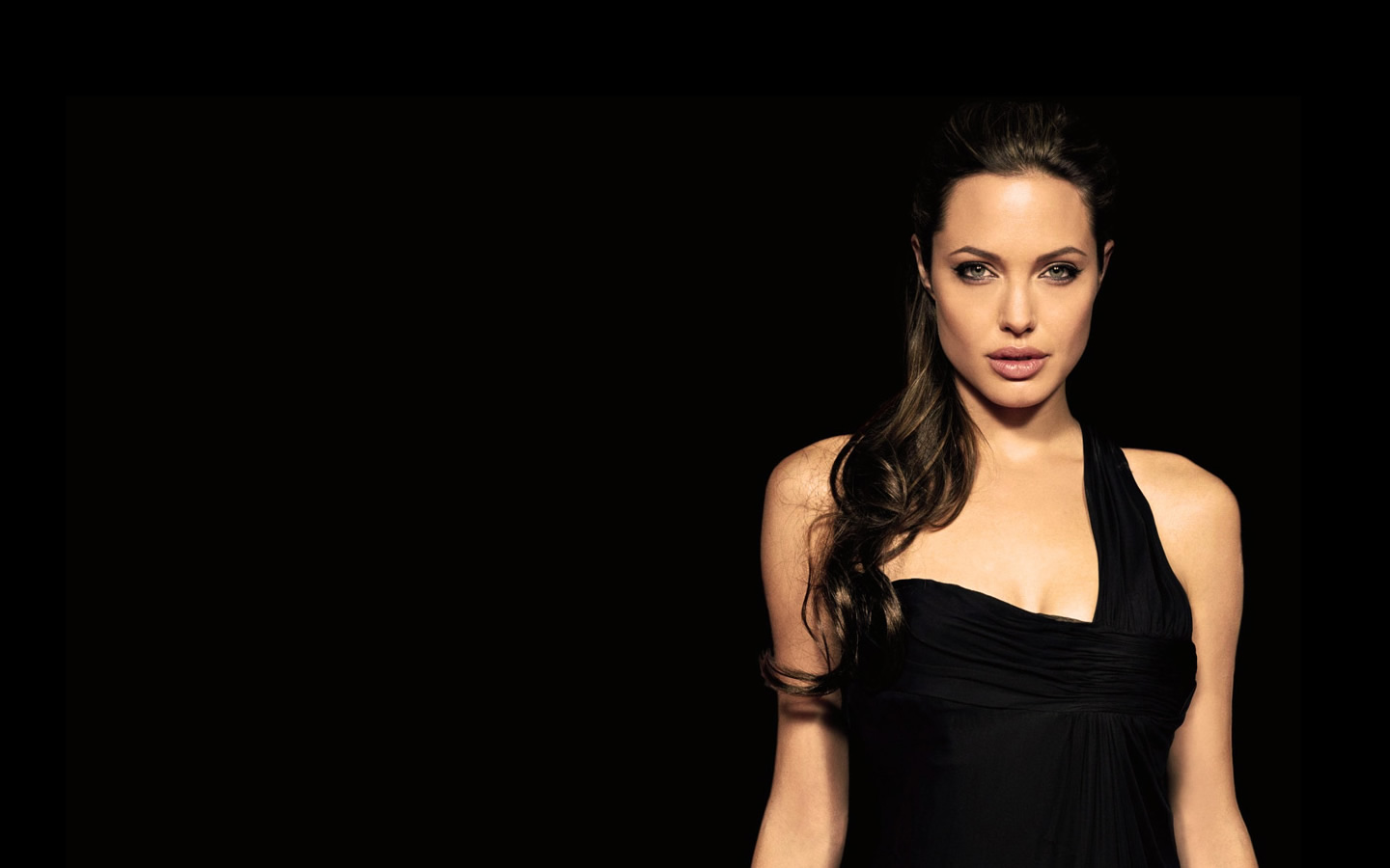 Angelina Jolie in black dress  Hot Bold Sexy Pics in Hollywood Actress