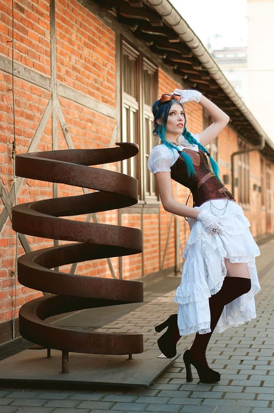 Steampunk woman with blue hair. Her steampunk clothing includes a white dress, copper corset, copper goggles, white lace gloves, black stockings and heels.