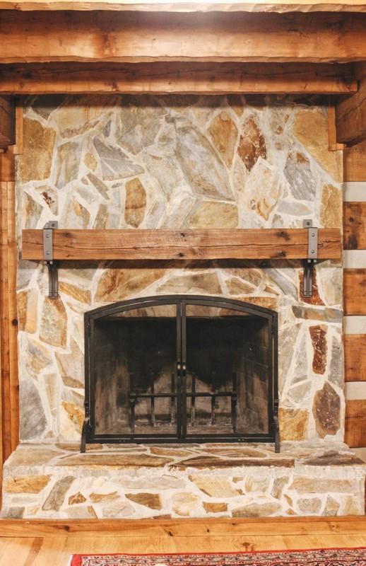 stone-fireplace-antique-reclaimed-rustic-beam-mantel-steel-bracket-log-cabin