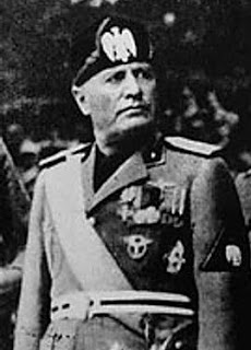 Mussolini in familiar pose as the military dictator