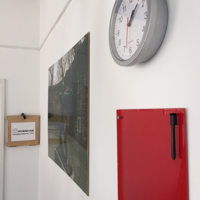 Cryptology Nottingham Review | Morgan's Milieu: A clock on the wall with a red board beneath it.