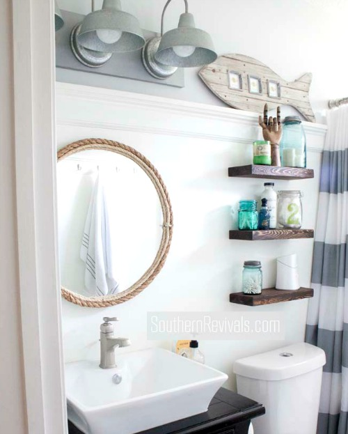 Small nautical bathroom makeover with tons of diy ideas for Kitchen cabinets lowes with seashell wall art craft