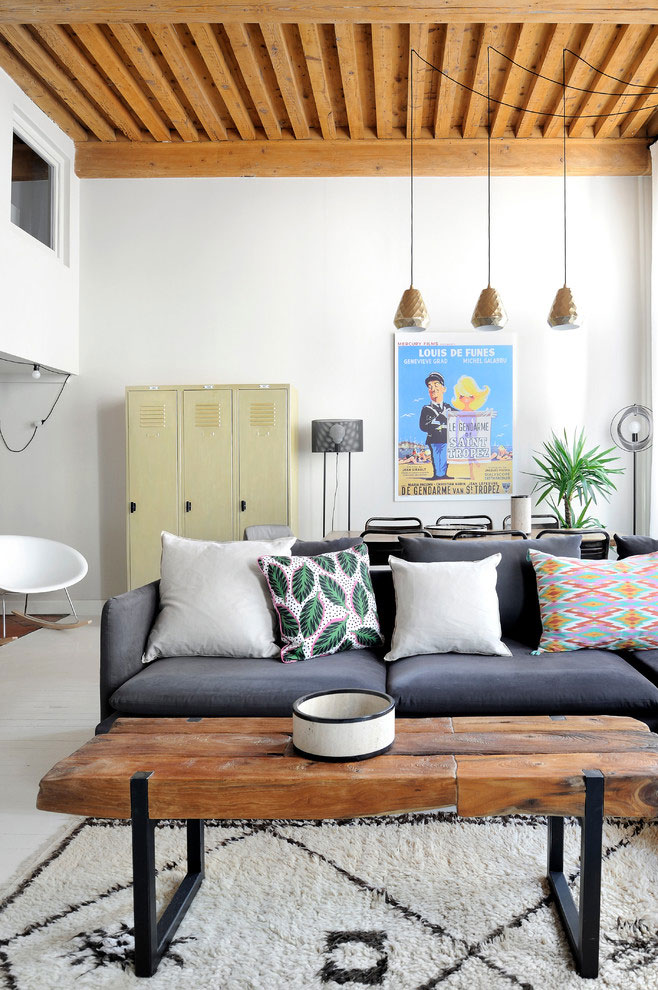 French loft with wooden beams, mid century modern furniture, white floors, colorful details, living room