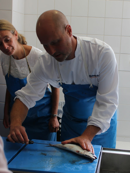 Our chef, Sean, showing us how to cut open the chamber of the fish