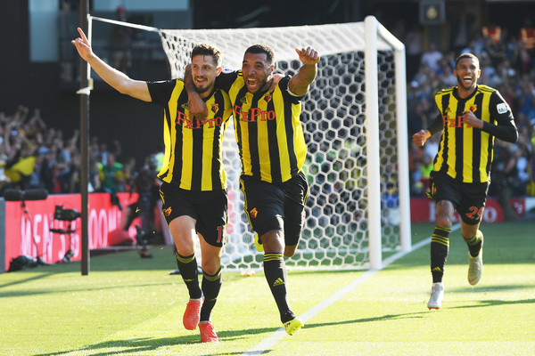 Craig Cathcart of Watford celebrates with his captain Troy Deeney after scoring the winner during the Premier League match between Watford FC and Tottenham Hotspur at Vicarage Road on September 2, 2018 in Watford, United Kingdom.