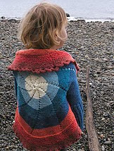 http://www.ravelry.com/patterns/library/pinwheel-sweater-child