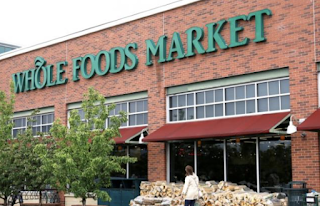 For Whole Foods workers, fears of robots, drones and culture clash