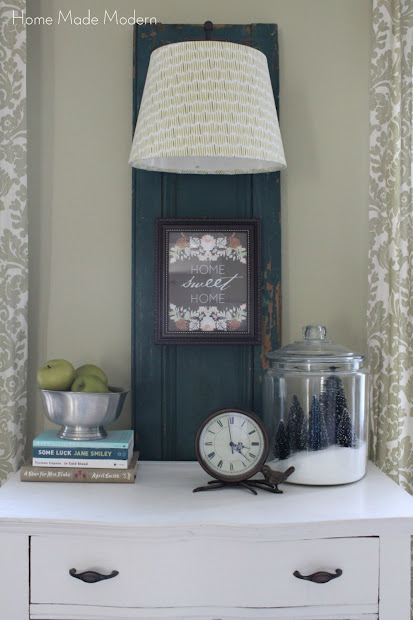 wall lamp hung on vintage shutter