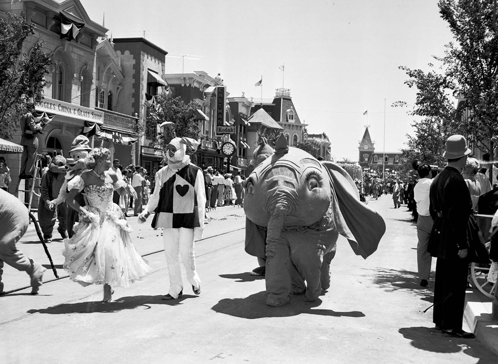 Dumbo and other characters from Disney movies appear in a parade down Main Street, U.S.A., at the Disneyland opening on July 17, 1955.