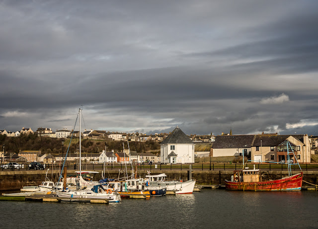 Photo of a heavy sky over Maryport Marina