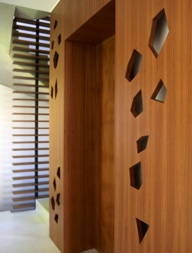 Cut out details on the wooden wall