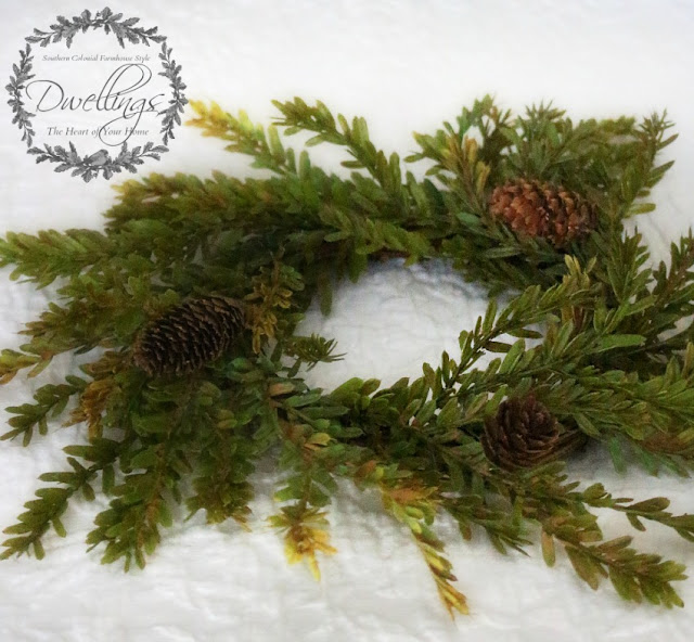 Pine cone wreath used with silver dish for a candle in the guest room.