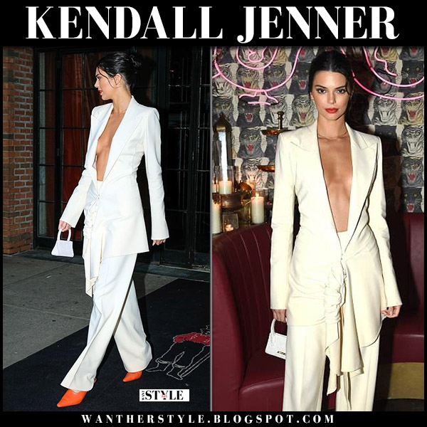 Kendall Jenner in white plunging jacket, white pants and orange mules dorateymur model style may 8