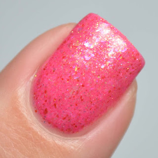 coral crelly nail polish with flakies