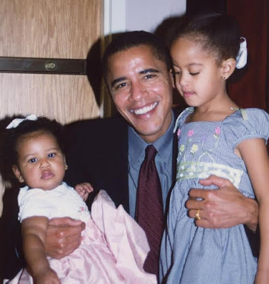 """""""Our daughters may be older and taller now, but they'll always be your little girls"""" Michelle Obama writes to Barack on Father's Day"""