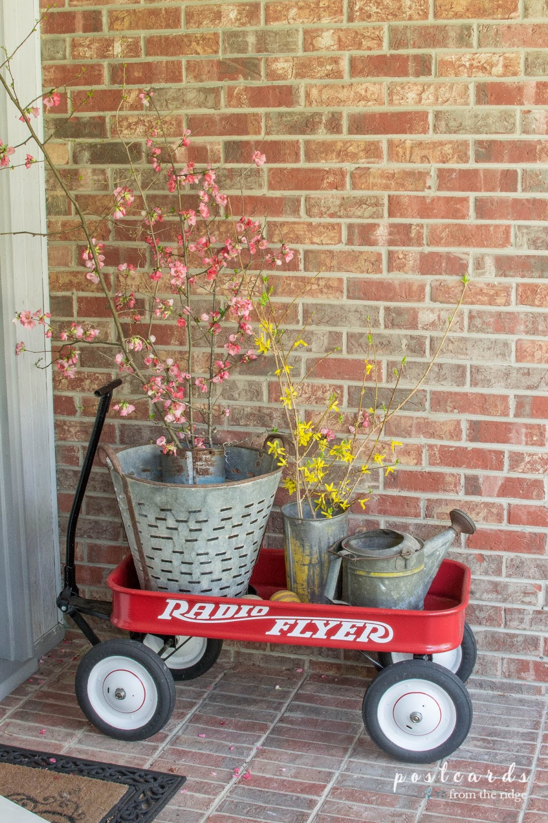radio flyer wagon with clipped branches and vintage metal buckets