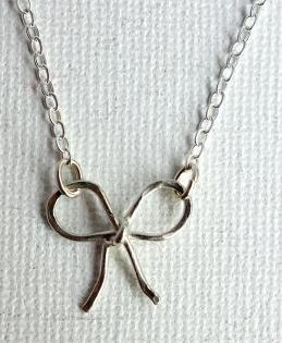 Handmade Petite Sterling Silver Bow Necklace by Rachel Pfeffer. Via Diamonds in the Library.