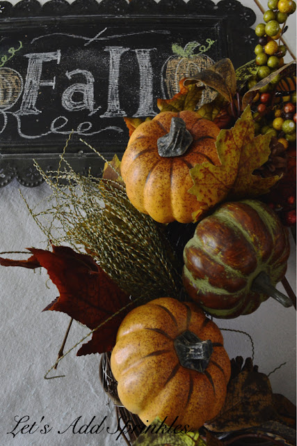 Pumpkin wreath on a fall chalkboard