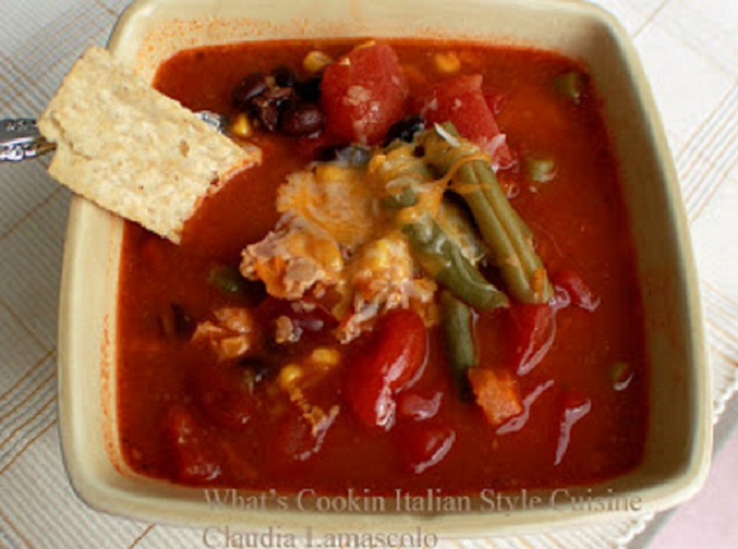 this is a soup or chili Southwestern style with beans, green beans, black beans, cheeses and tomato sauce