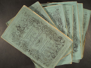A stack of paper-bound issues of David Copperfield.
