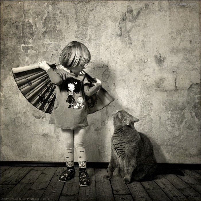Fotografia tierna de niña y gato
