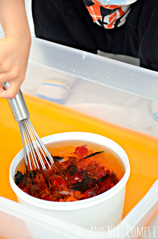 Fine motor practice for toddlers and preschoolers in a fall/autumn water sensory bin from And Next Comes L