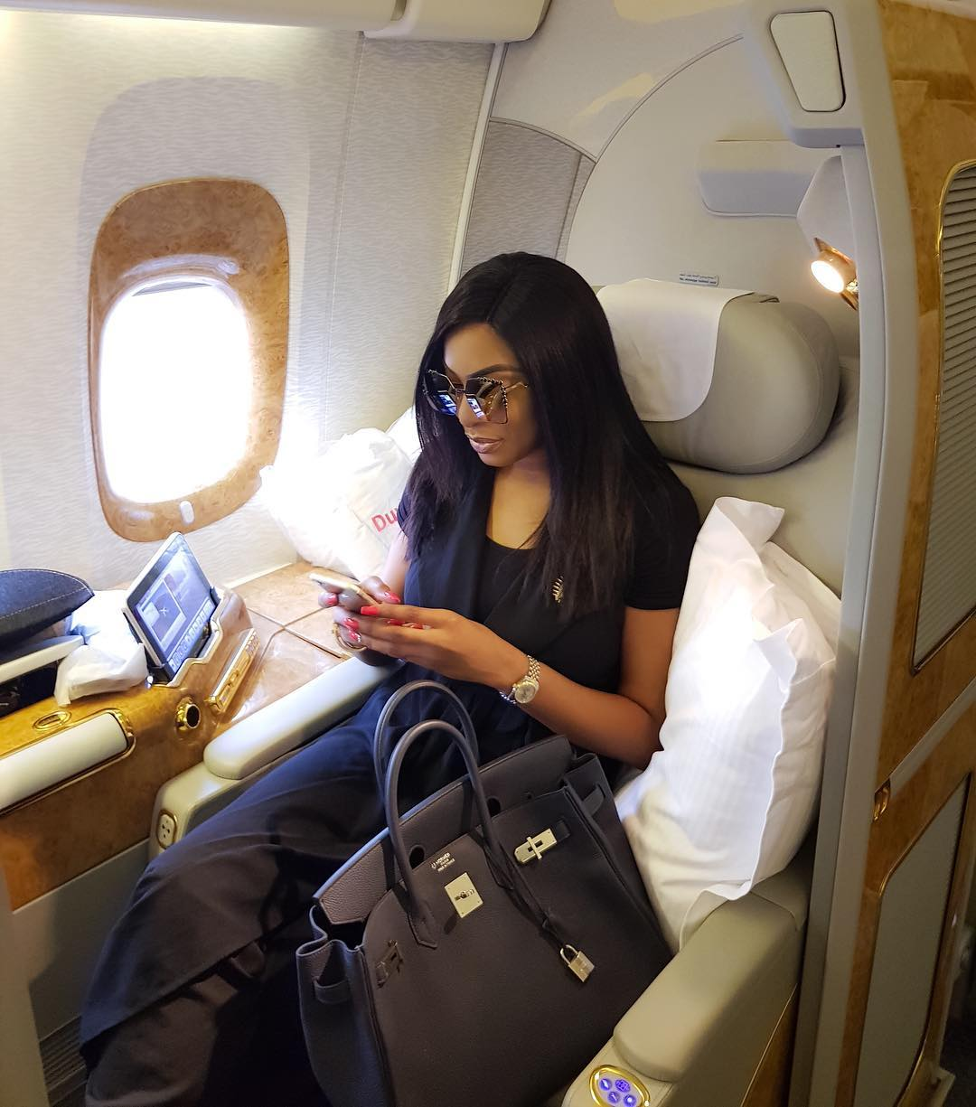 0d24ae9ca1db Chika Ike shows off her Hermes Birkin bag in first class seat..