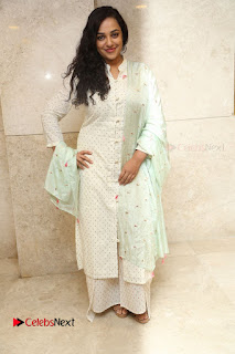 Actress Nithya Menen Latest Pictures in White Dress at 100 Days of Love Movie Audio Launch  0131.JPG