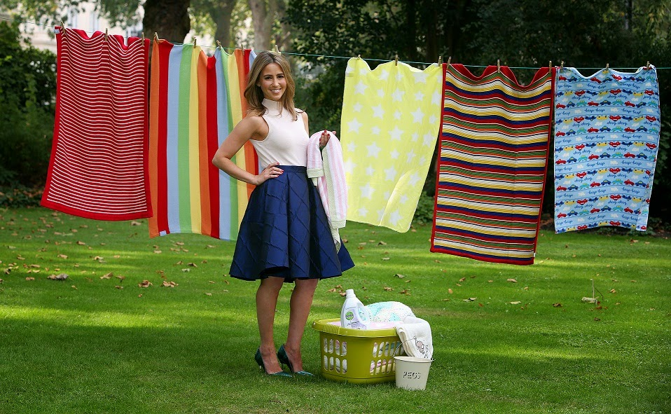 Rachel Stevens with baby blankets Dettol campaign