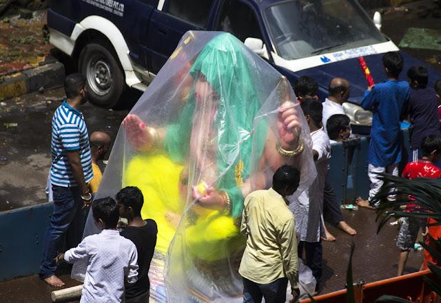 cover, ganesha, idol, india, monsoon, mumbai, plastic, protection, raincoat, rains, streetphoto,