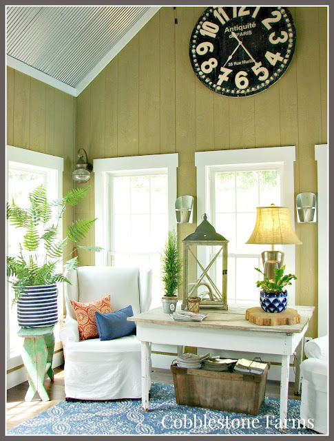 farm, farmhouse, farmhouse tour, sun porch, sunroom, slipcovered furniture, slipcovers, farmhouse table, windows, blue rug, pillows, pops of color