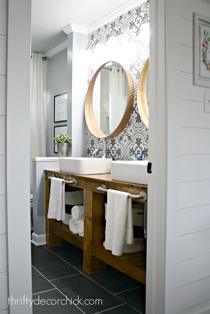 wood bathroom vanity with patterned backsplash wall