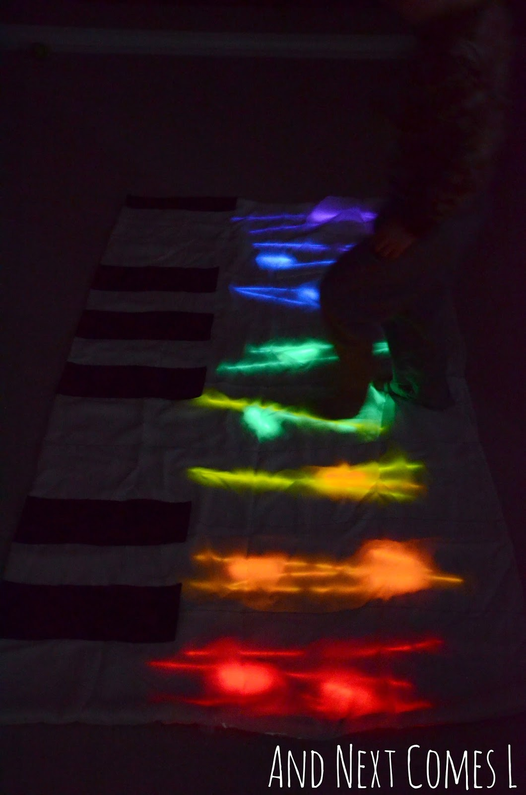 Gross motor play on a homemade glowing floor piano from And Next Comes L